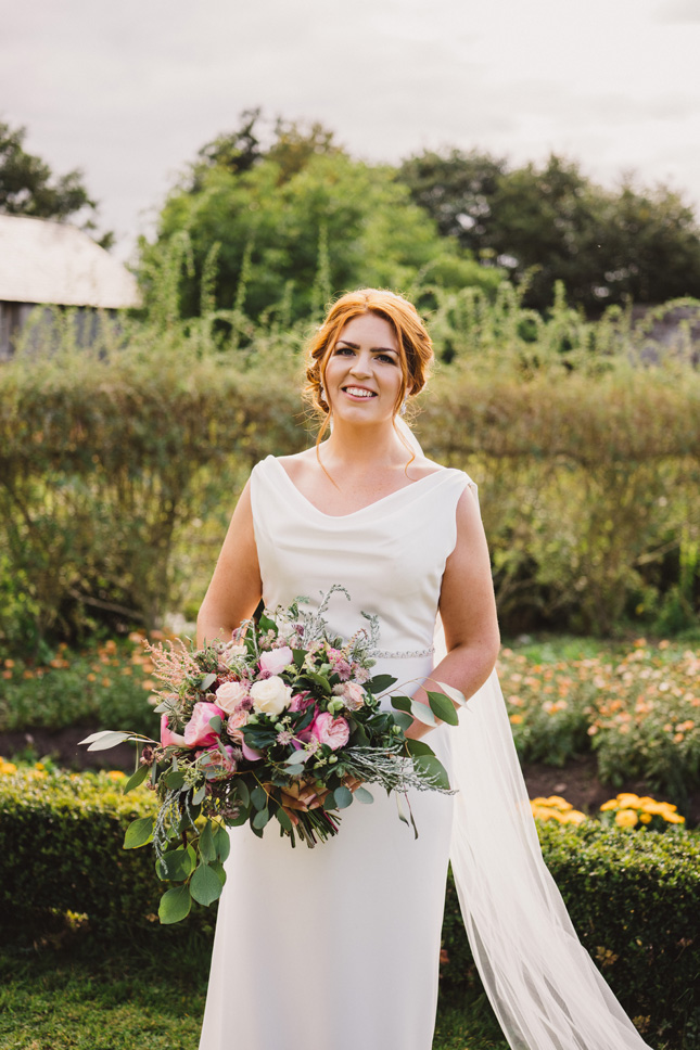 pink wedding bouquet red haired bride